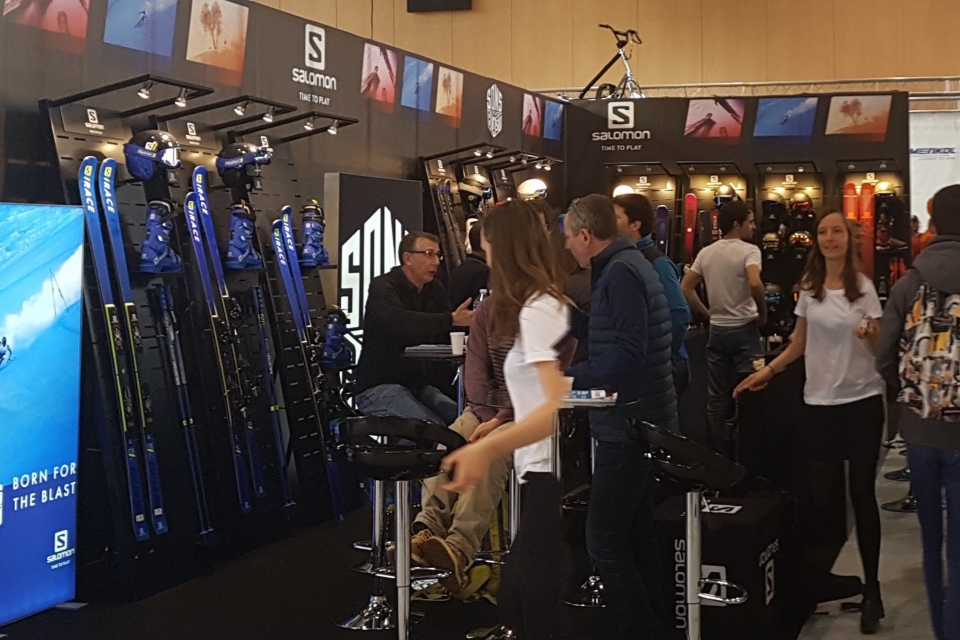 Amer Sports skis helmets and shoes displays